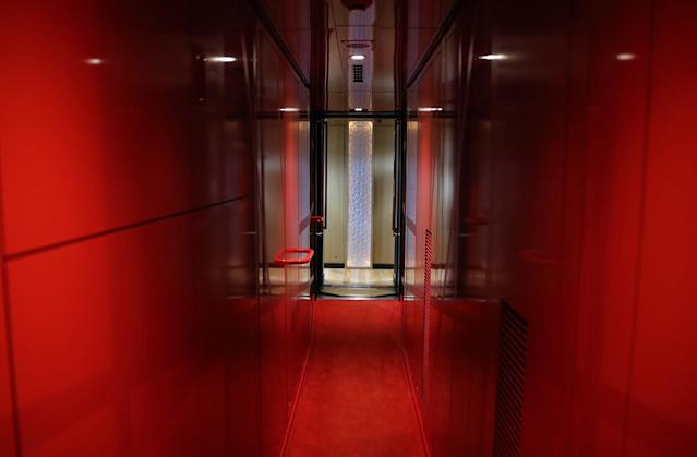 <p>A corridor aboard the Train Suite Shiki-shima is shown during a press preview in Tokyo. (Photo: Asahi Shimbun via Getty Images) </p>