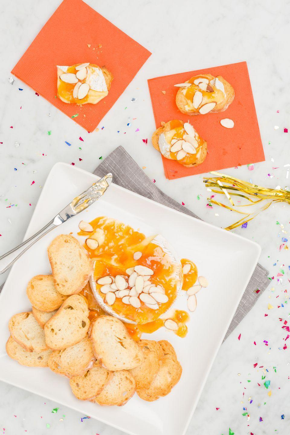 """<p>Your NYE party needs this fancy, stupid-simple appetizer.</p><p>Get the recipe from <a href=""""https://www.delish.com/cooking/recipe-ideas/recipes/a44686/baked-brie-recipe/"""" rel=""""nofollow noopener"""" target=""""_blank"""" data-ylk=""""slk:Delish"""" class=""""link rapid-noclick-resp"""">Delish</a>.</p>"""