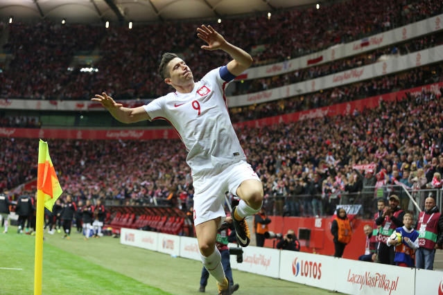 In this photo taken on Sunday, Oct. 8, 2017, Poland's Robert Lewandowski celebrates after he scored a goal during the World Cup Group E qualifying soccer match between Poland and Montenegro at National stadium in Warsaw, Poland, Sunday, Oct. 8, 2017. (AP Photo/Czarek Sokolowski)