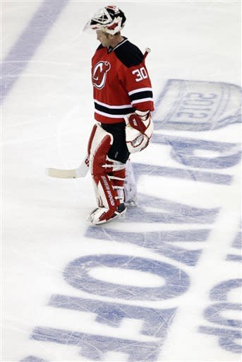 New Jersey Devils' Martin Brodeur skates during a breack in the third period of game 3 of an NHL hockey Stanley Cup Eastern Conference final playoff series against the New York Rangers, Saturday, May 19, 2012, in Newark, N.J. (AP Photo/Frank Franklin II)