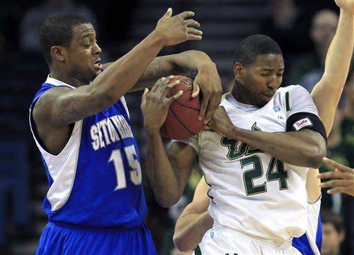 Seton Hall forward Herb Pope (15) ties up South Florida forward Augustus Gilchrist (24) during the first half of an NCAA college basketball game, Friday Jan. 13, 2012, in Tampa, Fla. (AP Photo/Chris O'Meara)
