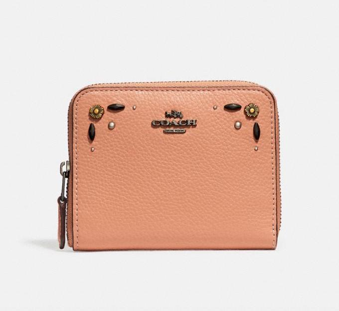 Small Zip Around Wallet With Prairie Rivets Detail. Image via Coach.