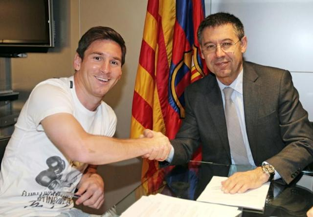 Josep Maria Bartomeu signed Lionel Messi to new contracts in 2014 and in 2017 and says the club has an obligation to keep its star player (AFP Photo/MIGUEL RUIZ)