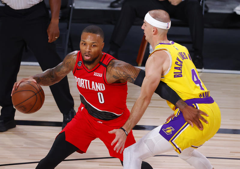 Portland Trail Blazers' Damian Lillard drives the ball