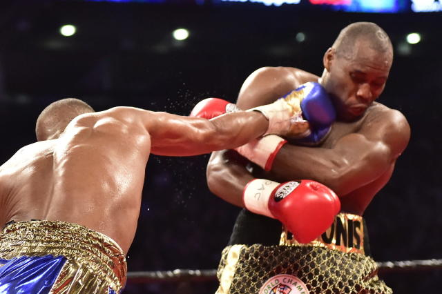 Adonis Stevenson, right, takes a punch from Badou Jack during the WBC light heavyweight championship boxing match in Toronto on Saturday, May 19, 2018. (Frank Gunn/The Canadian Press via AP)