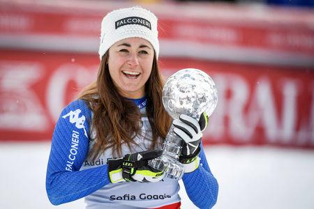 Alpine Skiing - FIS Alpine Skiing World Cup - Women's Downhill - Are, Sweden - March 14, 2018. Sofia Goggia of Italy celebrates with the trophy after winning the FIS Downhill World Cup, after placing second in the women's final race. Anders Wiklund/TT News Agency via Reuters