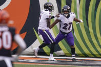 Baltimore Ravens running back J.K. Dobbins (27) celebrates with quarterback Tyler Huntley (2) after scoring a touchdown against the Cincinnati Bengals during the second half of an NFL football game, Sunday, Jan. 3, 2021, in Cincinnati. (AP Photo/Bryan Woolston)