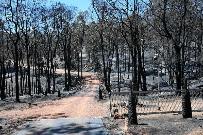 A burned fire ground is shown near Wooroloo, northeast of Perth.