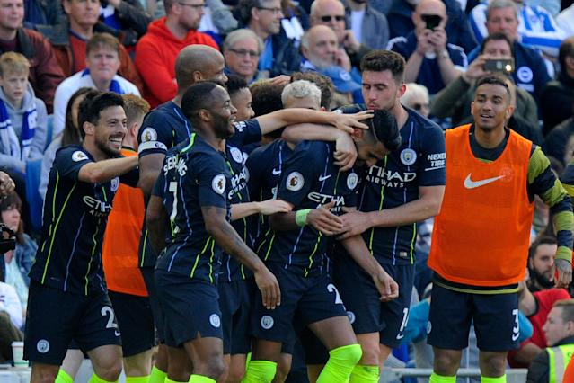 Riyad Mahrez celebrates as Man City win the Premier League at Brighton. (Photo by MB Media/Getty Images)