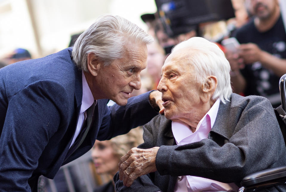 Kirk Douglas (R) attends a ceremony honouring his son Michael Douglas (L) with a Star on Hollywood Walk of Fame, in Hollywood, California on November 6, 2018. (Photo by VALERIE MACON / AFP via Getty Images)