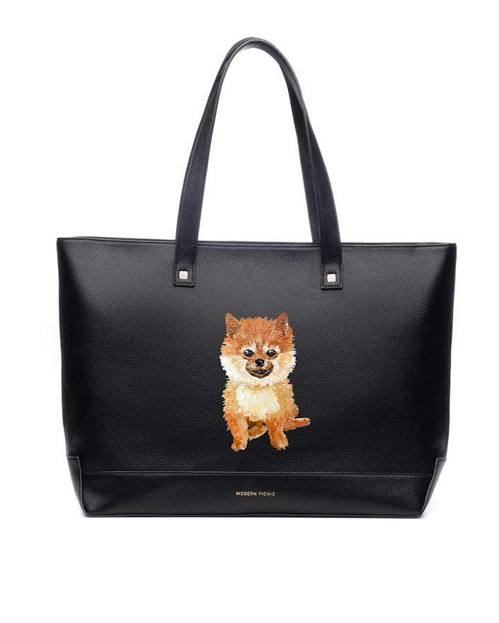 """<p>Dog parents can keep their pets close, even while their out of the house, with this custom purse. </p> <p><strong>Buy it!</strong> The Pet Portrait Tote, $260.00; <a href=""""https://modernpicnic.com/products/pet-portrait-tote"""" rel=""""sponsored noopener"""" target=""""_blank"""" data-ylk=""""slk:ModernPicnic.com"""" class=""""link rapid-noclick-resp"""">ModernPicnic.com</a></p>"""