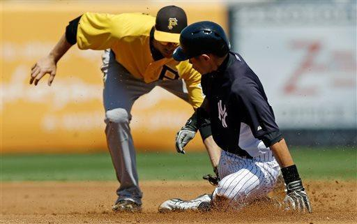 New York Yankees Ichiro Suzuki is tagged out trying to steal second base by Pittsburgh Pirates second baseman Neil Walker during the first inning of a spring training baseball game at Steinbrenner Field in Tampa, Fla., Thursday, March 28, 2013. (AP Photo/Kathy Willens)
