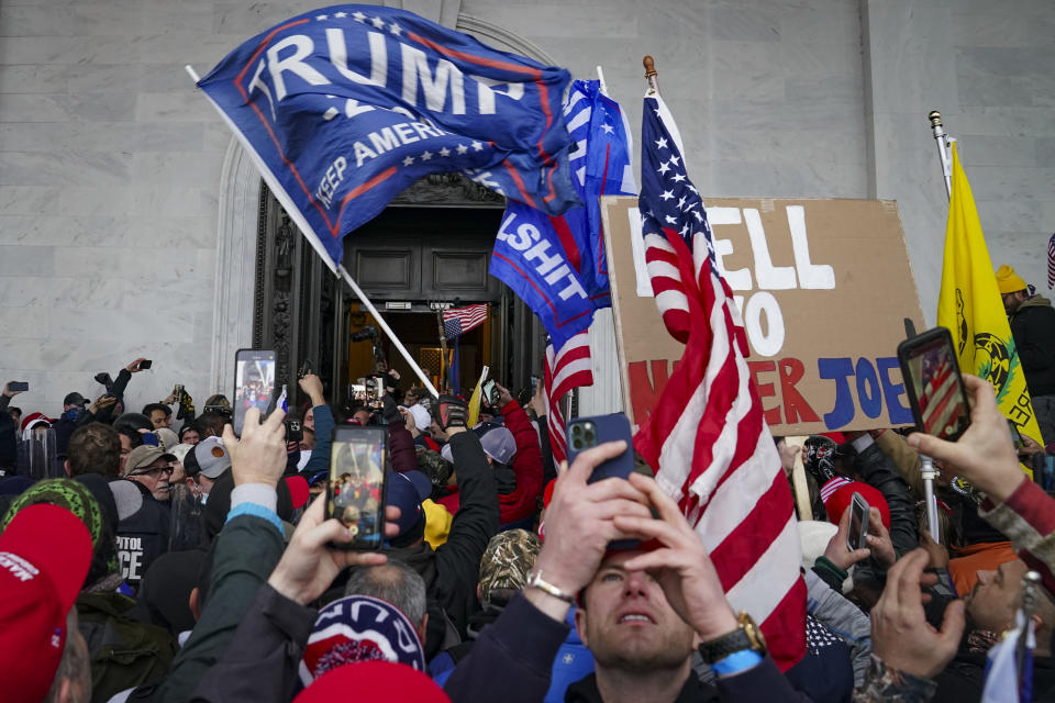 FILE - In this Jan. 6, 2021, file photo, Trump supporters gather outside the Capitol in Washington. Online supporters of Trump are scattering to smaller social media platforms, fleeing what they say is unfair treatment by Facebook, Twitter and other big tech firms looking to squelch misinformation and threats of violence. (AP Photo/John Minchillo, File)