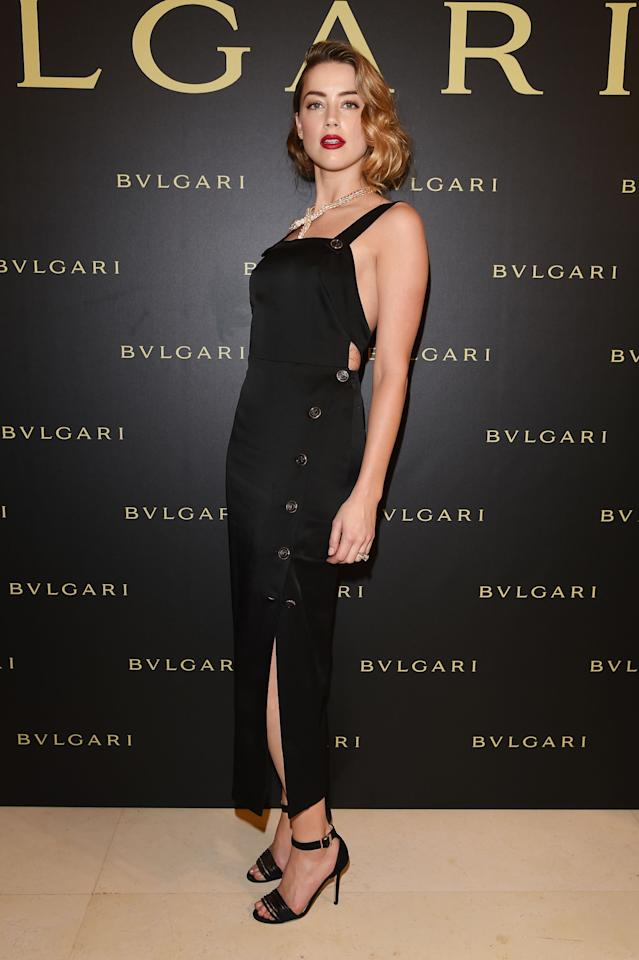 <p>Amber Heard in Temperley London LBD dress.</p><p>After a long weekend of red, white and blues, it seems like this weeks best dressed are having a bit of a black and white moment. Case in point: actress Amber Heard, who attended the Buglari cocktail party in a figure-hugging LBD from Temperley London, topped off with a sparkling signature serpent necklace.<br /><br /></p>