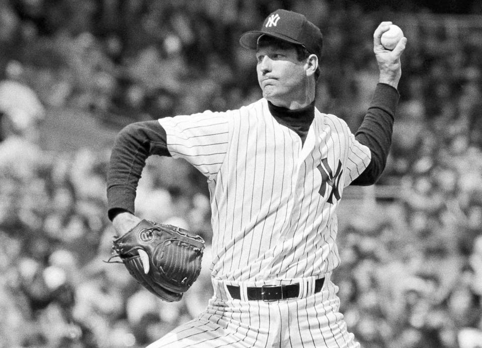 THS DELETES ANY REFERENCE TO TOMMY JOHN BEING A COVID DENIER - FILE - In this 1979 file photo, New York Yankees pitcher Tommy John delivers during a baseball game. Tommy John has been battling COVID-19 for at least three weeks. The 77-year-old former pitching great remains hospitalized near his home in Indio, California. He said he started to feel ill following a trip to Nashville before he was hospitalized on Dec. 13. (AP Photo/File)