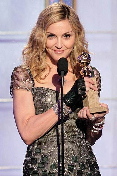 <p>Even Madonna won an award, taking home 'Best Original Song' for the song 'Masterpiece,' which she wrote for her movie 'W.E.'</p>