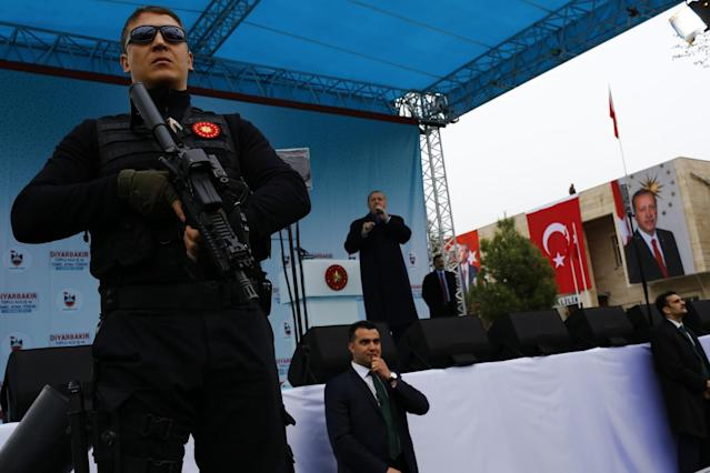 <p>Turkish President Tayyip Erdogan addresses his supporters as his guards secure the stage during a rally for the upcoming referendum in the Kurdish-dominated southeastern city of Diyarbakir, Turkey, April 1, 2017. (Murad Sezer/Reuters) </p>