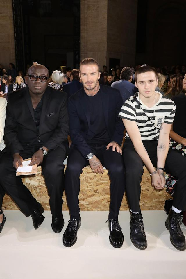 <p>Edward Enningful, David Beckham, and Brooklyn Beckham attend the Victoria Beckham show on September 10, 2017 in New York City. (Photo by Darren Gerrish/Getty Images) </p>