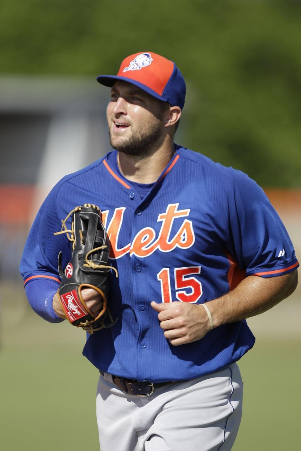 <p>Tim Tebow jogs on the field during a practice before his first instructional league baseball game for the New York Mets against the St. Louis Cardinals instructional club Wednesday, Sept. 28, 2016, in Port St. Lucie, Fla. (AP Photo/Luis M. Alvarez) </p>