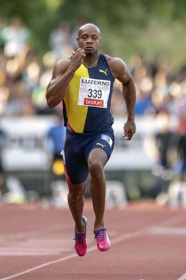 FILE - In this July 9, 2019, file photo, Asafa Powell, from Jamaica, competes in the 100m event at an International Athletics Meeting in Lucerne, Switzerland. American Justin Gatlin and Jamaican Asafa Powell may be late 30-something sprinters but they feel as youthful as ever. They still think they can give the younger generation a run for their money. (Urs Flueeler/Keystone via AP, File)