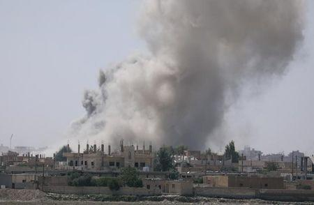 FILE PHOTO: Smoke rises from the al-Mishlab district at Raqqa's southeastern outskirts