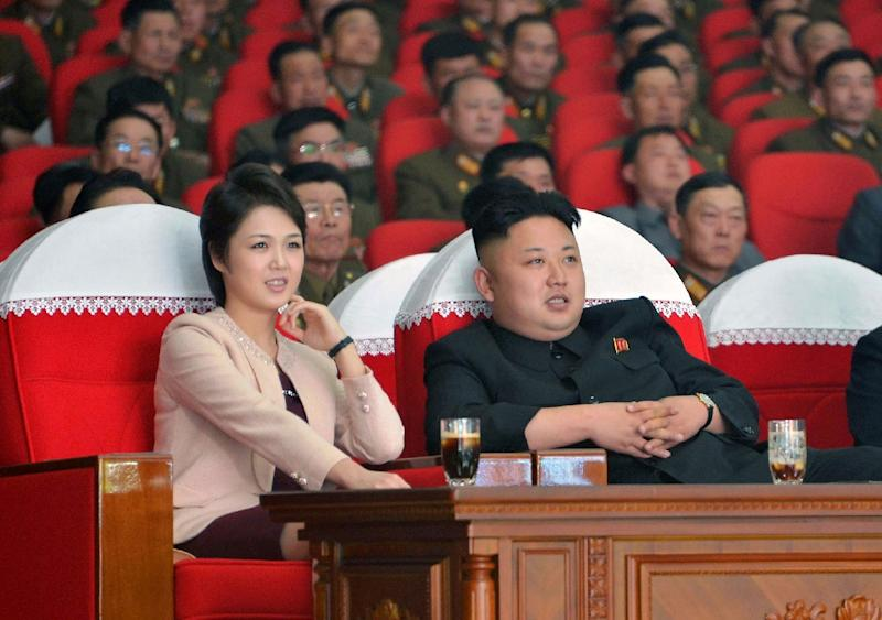 North Korean leader Kim Jong-Un and his wife Ri Sol-Ju watches a performance by the Moranbong Band at the April 25 House of Culture on March 22, 2014 (AFP Photo/)