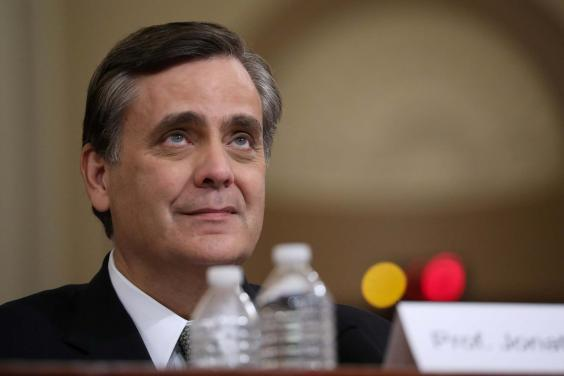Jonathan Turley, professor of law at George Washington University Law School, listens to questions while testifying during the hearing (Reuters)