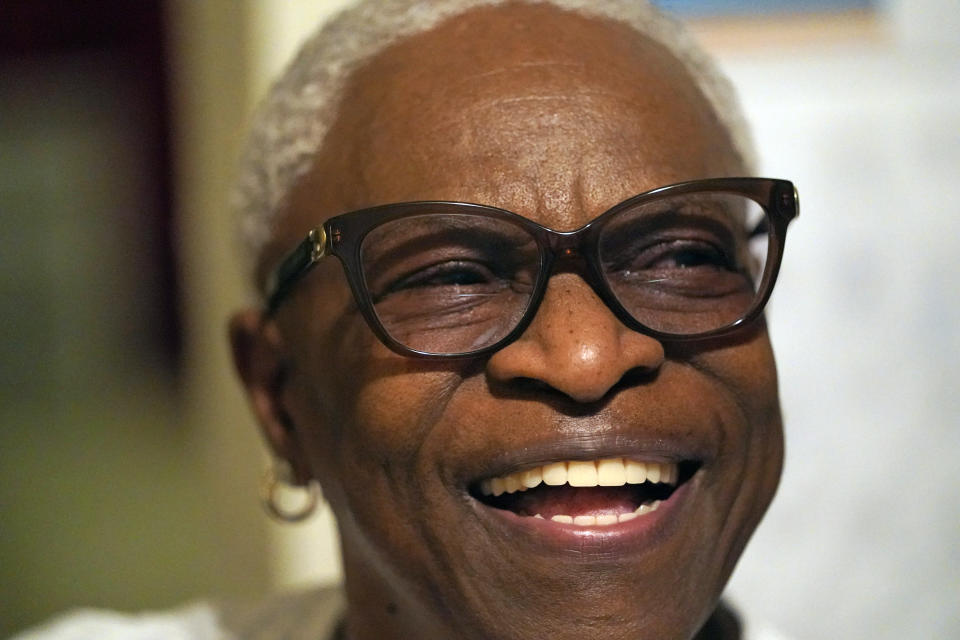 Doris Brown laughs as she answers a question during an interview inside her home Friday, July 31, 2020, in Houston. Brown's home flooded during Harvey and she's part of a group called the Harvey Forgotten Survivors Caucus. (AP Photo/David J. Phillip)