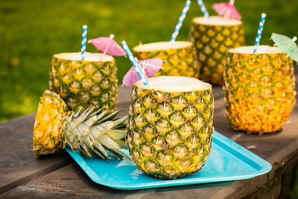 "<p>You won't mind getting lost in the rain when you're sipping one of these.</p><p>Get the recipe from <a href=""https://www.delish.com/cooking/videos/a47265/how-to-make-pineapple-cups/"" rel=""nofollow noopener"" target=""_blank"" data-ylk=""slk:Delish"" class=""link rapid-noclick-resp"">Delish</a>.</p>"