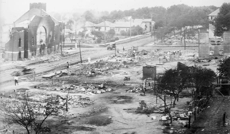 This June 1921 handout photo obtained May 19, 2021, courtesy of the Library of Congress, shows the aftermath of the burning of buildings, after the Tulsa Race Massacre in Tulsa, Oklahoma