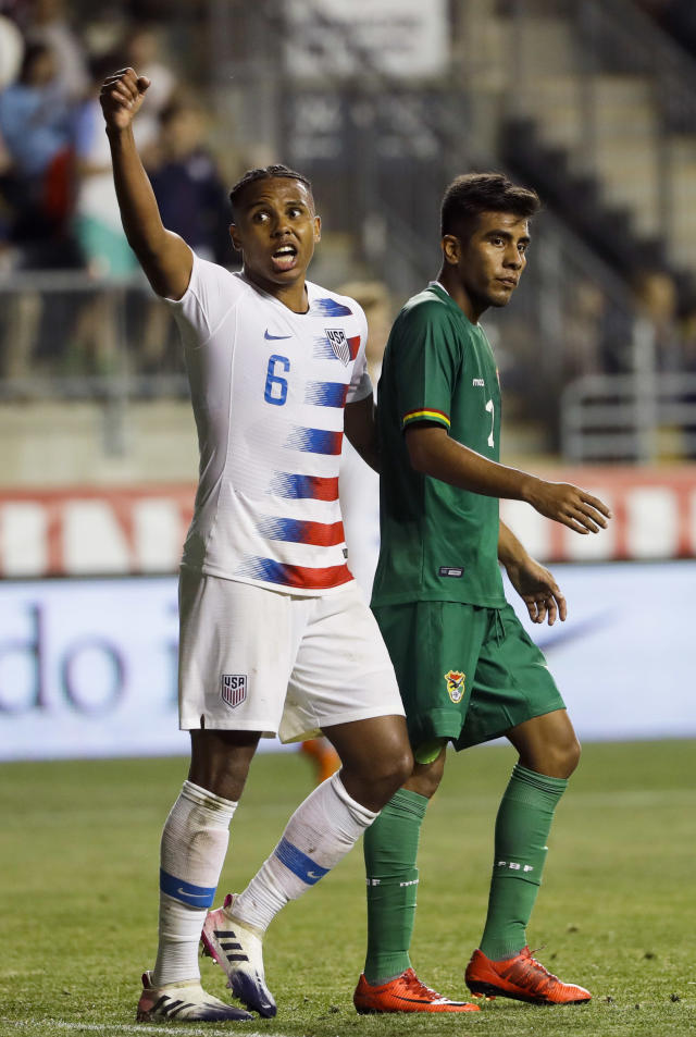 United States' Weston McKennie, left, celebrates past Bolivia's Carlos Anez after an international friendly soccer match, Monday, May 28, 2018, in Chester, Pa. The United States won 3-0. (AP Photo/Matt Slocum)