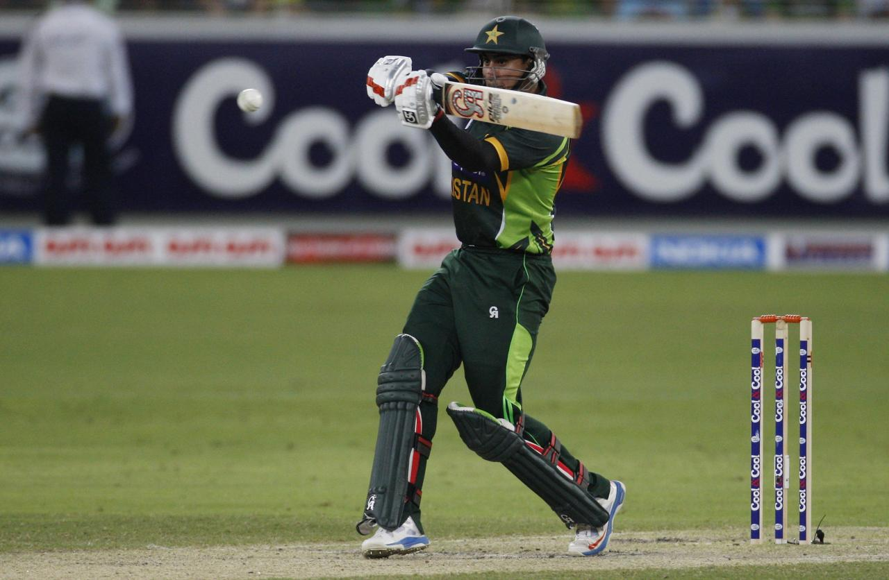 Pakistan's Nasir Jamshed plays a shot during their second Twenty20 international cricket match against South Africa in Dubai November 15, 2013. REUTERS/Nikhil Monteiro(UNITED ARAB EMIRATES - Tags: SPORT CRICKET)