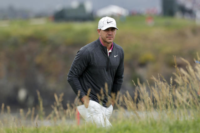 Brooks Koepka walks to the 17th green during the second round of the U.S. Open Championship golf tournament Friday, June 14, 2019, in Pebble Beach, Calif. (AP Photo/Matt York)