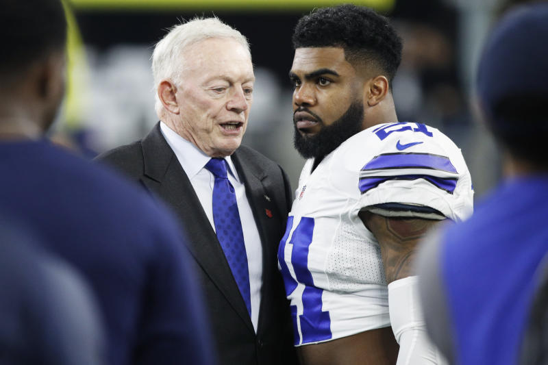 Ezekiel Elliott, right, reportedly won't play for the Cowboys in 2019 without a new contract; team owner/GM Jerry Jones says he's not worried about getting a deal done. (Getty Images)