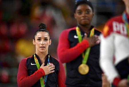 2016 Rio Olympics - Artistic Gymnastics - Final - Women's Individual All-Around Victory Ceremony - Rio Olympic Arena - Rio de Janeiro, Brazil - 11/08/2016. Alexandra Raisman (USA) of the U.S. poses with her silver medal. REUTERS/Dylan Martinez