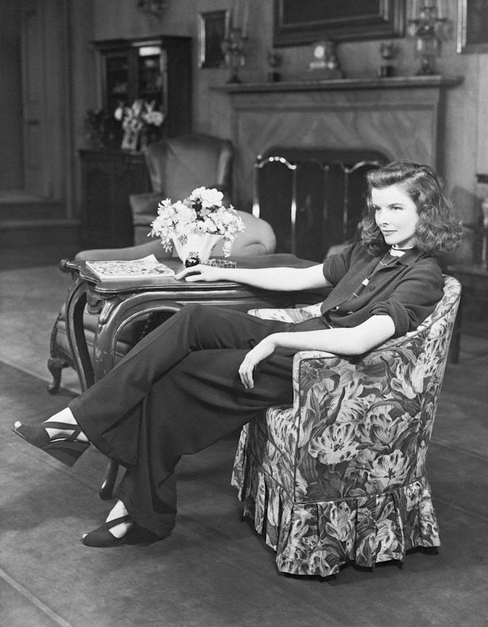 """<p>Katharine Hepburn famously rejected her studio's guidelines on dress code and reportedly walked around set in her underwear, refusing to get dressed, after someone in the costume department at <a href=""""https://www.biography.com/actor/katharine-hepburn"""" rel=""""nofollow noopener"""" target=""""_blank"""" data-ylk=""""slk:RKO Radio Pictures took her pants away"""" class=""""link rapid-noclick-resp"""">RKO Radio Pictures took her pants away</a>. </p>"""