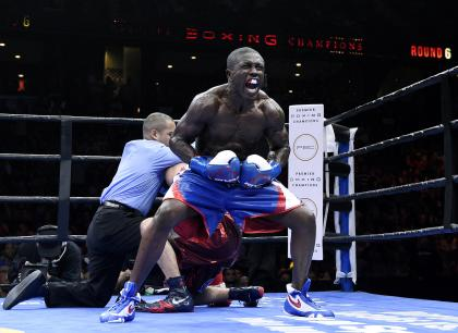 Andre Berto (C) celebrates after knocking out Josesito Lopez in March. (Getty)