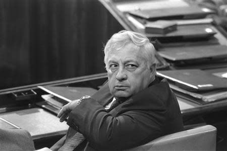 Israel's Minister of Industry and Trade Ariel Sharon sits in a session of Israel's parliament in Jerusalem May 6, 1985 in this file photo released by the Government Press Office. REUTERS/Nati Harnik/Government Press Office/Handout/Files