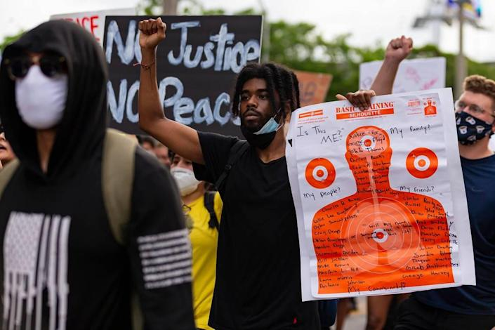 Activists make their way through Overtown during a Justice for George Floyd protest on Monday, June 1, 2020.