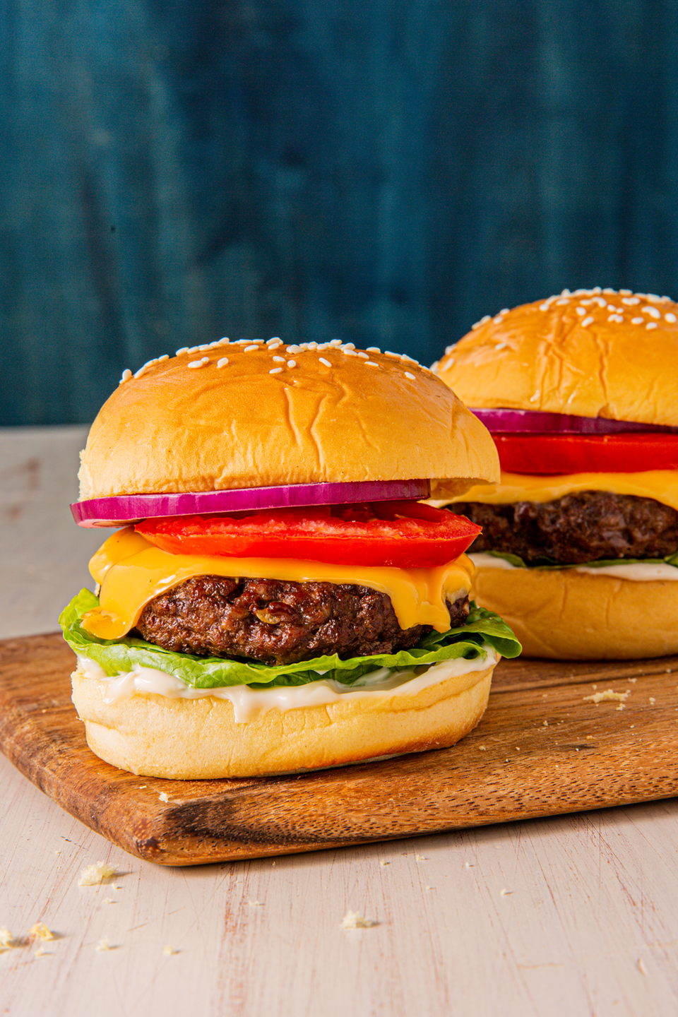 """<p>With the quick cook time, these <a href=""""https://www.delish.com/uk/cooking/recipes/g30993382/best-burger-recipes/"""" rel=""""nofollow noopener"""" target=""""_blank"""" data-ylk=""""slk:burgers"""" class=""""link rapid-noclick-resp"""">burgers</a> stay perfectly juicy and basically beg for a melty slice of cheese. Load it up with your favourite toppings and feel like the burger master you are - without all the smoke in your face. </p><p>Get the <a href=""""https://www.delish.com/uk/cooking/recipes/a32283836/air-fryer-hamburgers-recipe/"""" rel=""""nofollow noopener"""" target=""""_blank"""" data-ylk=""""slk:Air Fryer Cheeseburgers"""" class=""""link rapid-noclick-resp"""">Air Fryer Cheeseburgers</a> recipe.</p>"""