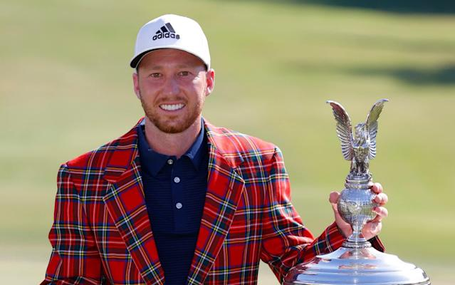 Daniel Berger celebrating with the trophy - Rory McIlroy capitulates as Daniel Berger secures anti-climactic play-off victory at the Charles Schwab Challenge - GETTY IMAGES