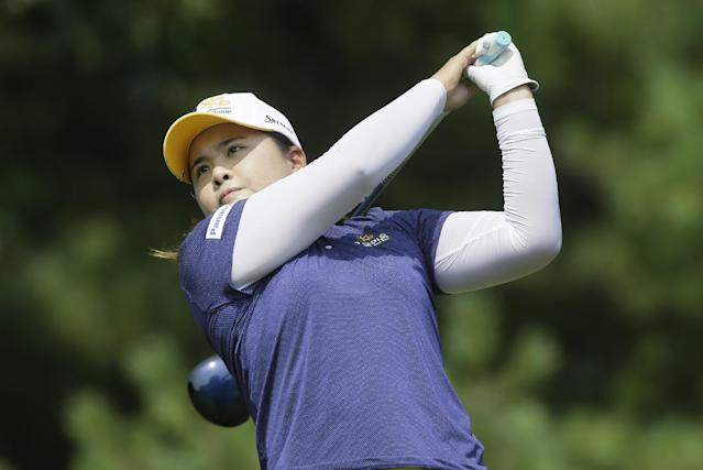 Inbee Park, of South Korea, drives on the third hole during the third round of the Meijer LPGA Classic golf tournament at Blythefield Country Club, Saturday, Aug. 9, 2014, in Belmont, Mich. (AP Photo/Carlos Osorio)