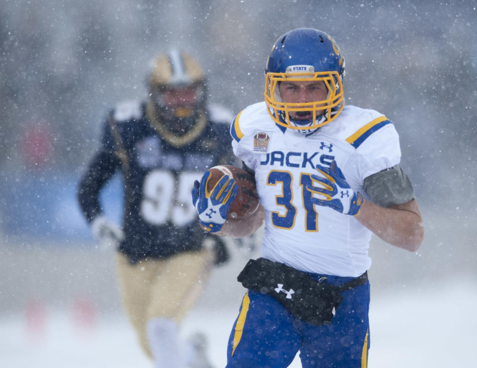 In this photo provided by Montana State University, South Dakota State running back Zach Zenner (31)scores a first quarter touchdown during an NCAA Football Championship Subdivision playoff game Saturday, Nov. 29, 2014 in Bozeman, Mont. (AP photo/Kelly Gorham)