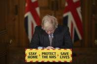 Britain's Prime Minister Boris Johnson reacts while leading a virtual press conference on the Covid-19 pandemic, inside 10 Downing Street in central London Tuesday Jan. 26, 2021. Official data shows that more than 100,000 people have died after testing positive for coronavirus in Britain, since the pandemic took hold last year. (Justin Tallis / Pool via AP)