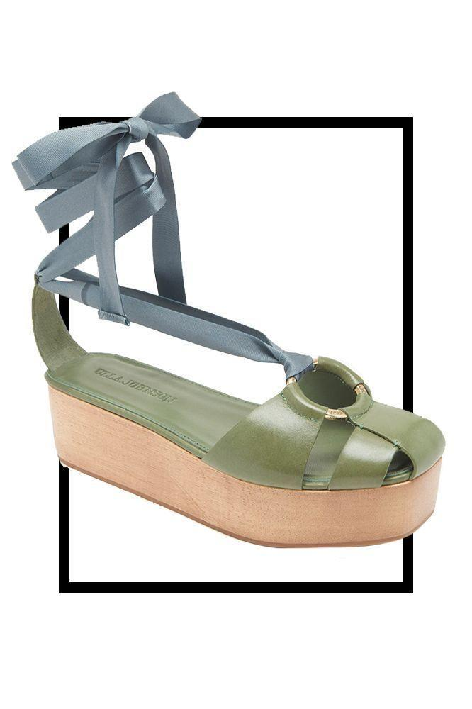 """<p><strong>Ulla Johnson</strong></p><p>Ulla Johnson</p><p><strong>$425.00</strong></p><p><a href=""""https://ullajohnson.com/products/mako-platform-atlantic?variant=32664820187232¤cy=USD&gclid=Cj0KCQiA-aGCBhCwARIsAHDl5x8uIbcJmB1HET3F7TKhg1IZNHsEQwgujOUPALy7jjNgY8xs_qYrd74aAgr4EALw_wcB"""" rel=""""nofollow noopener"""" target=""""_blank"""" data-ylk=""""slk:SHOP IT"""" class=""""link rapid-noclick-resp"""">SHOP IT</a></p><p>Ulla Johnson flatforms were some of the best from the Spring shows. Pair this green leather style with a long sundress for an easy springtime look.</p>"""