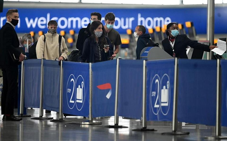 Some countries on the UK's quarantine-free list require passengers to present evidence of a negative test on arrival - Getty