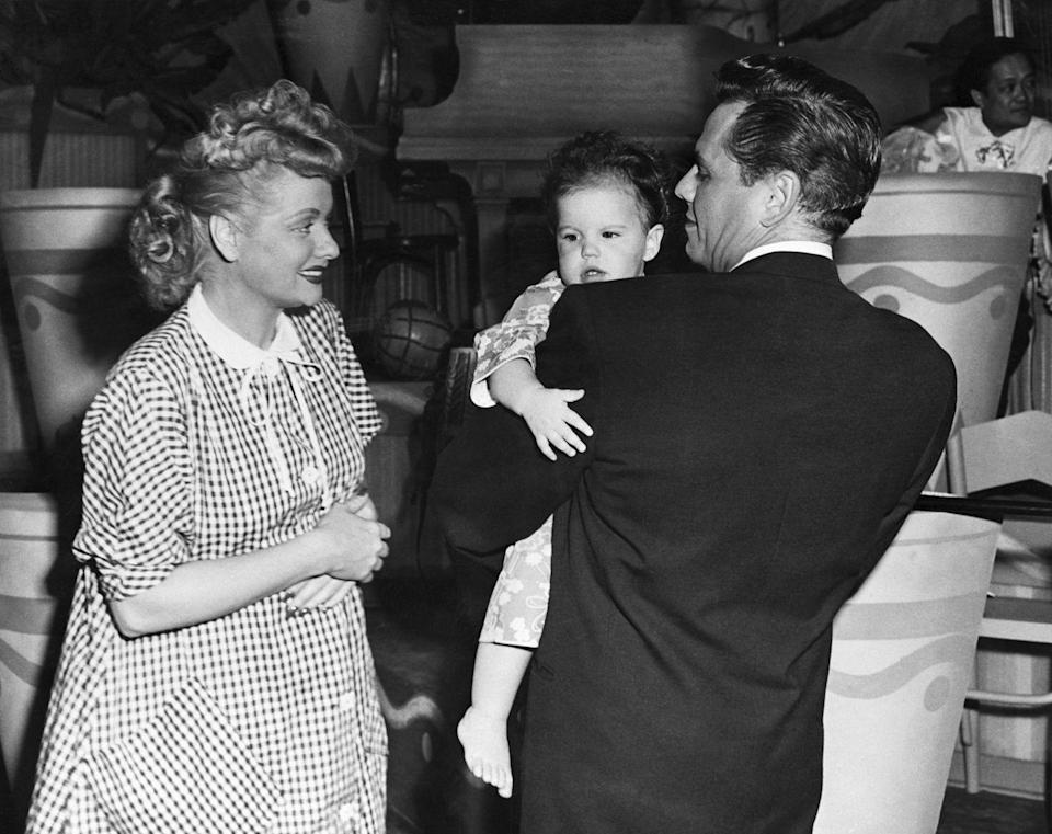 """<p>The couple fawns over their one-year-old daughter, Lucie Arnaz. That same year, the couple found out they were expecting a second child. Instead of covering up or working around the pregnancy — which was common at the time — they wrote the <a href=""""https://www.huffpost.com/entry/i-love-lucy-lucy-is-enceinte_n_3652507"""" data-ylk=""""slk:pregnancy into the storyline"""" class=""""link rapid-noclick-resp"""">pregnancy into the storyline</a> of the show's second season. </p>"""