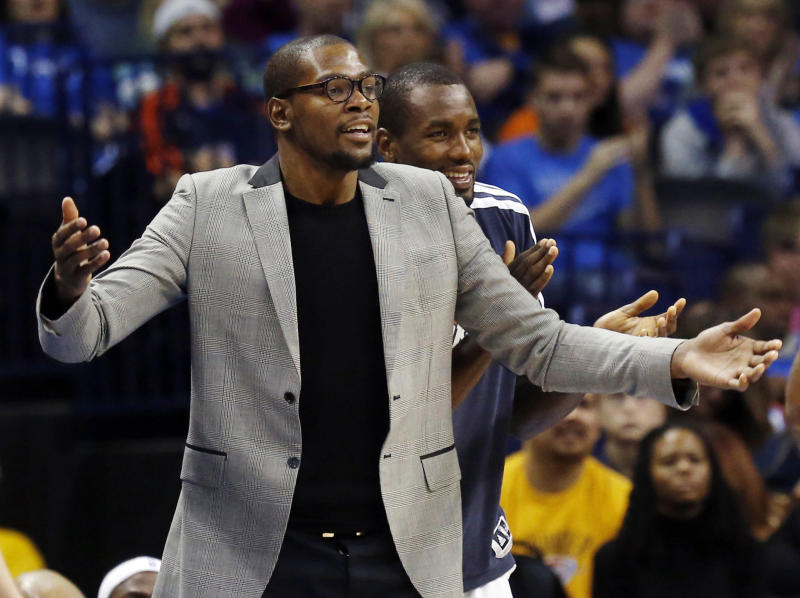 Oklahoma City Thunder forward Kevin Durant, left, gestures during the fourth quarter of an NBA basketball game against the Milwaukee Bucks in Oklahoma City, Wednesday, April 17, 2013. Milwaukee won 95-89. Thunder forward Serge Ibaka claps at right. (AP Photo/Sue Ogrocki)