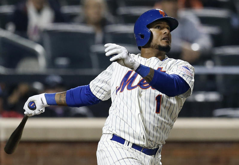 New York Mets' Jordany Valdespin (1) watches his 10th-inning, walk-off grand slam in their 7-3 win over the Los Angeles Dodgers in a baseball game at Citi Field in New York, Wednesday, April 24, 2013. (AP Photo/Kathy Willens)