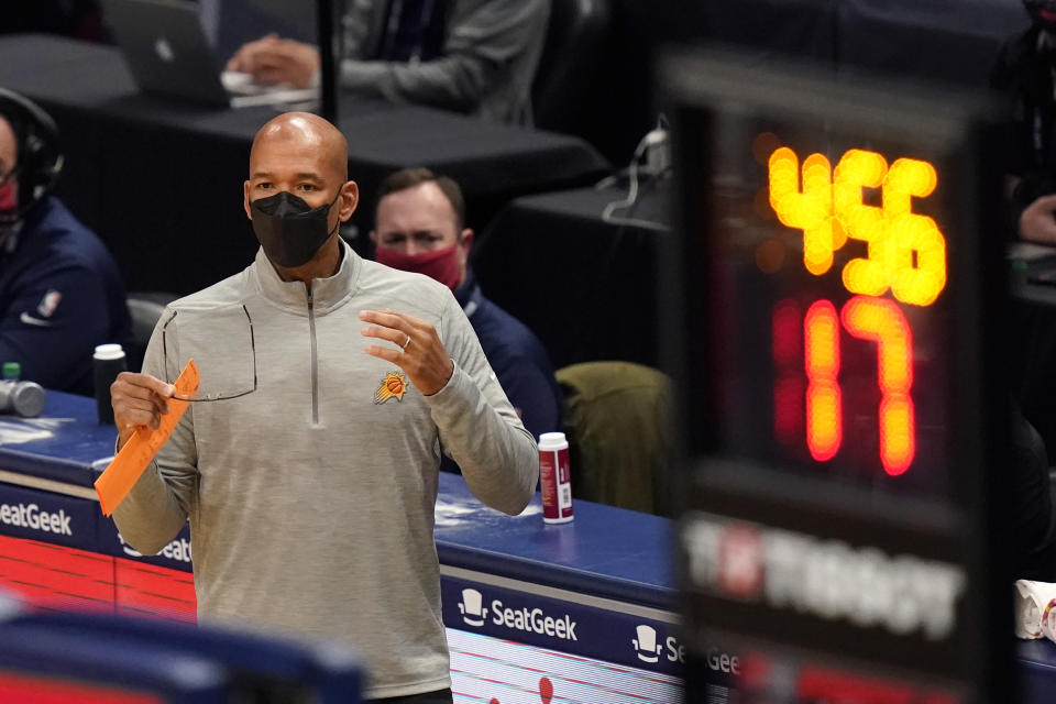 Phoenix Suns coach Monty Williams calls out from the bench during the second half of the team's NBA basketball game against the New Orleans Pelicans in New Orleans, Friday, Feb. 19, 2021. (AP Photo/Gerald Herbert)
